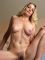 Superb blonde milf nude solo scenes in the bedroom